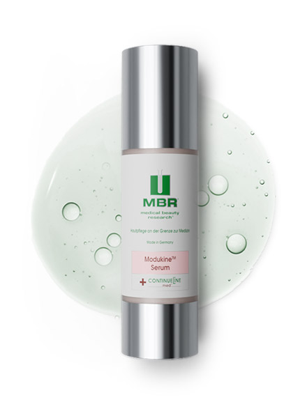 product arrangement of a modukine serum and a slightly green liquid with little bubbles in the background